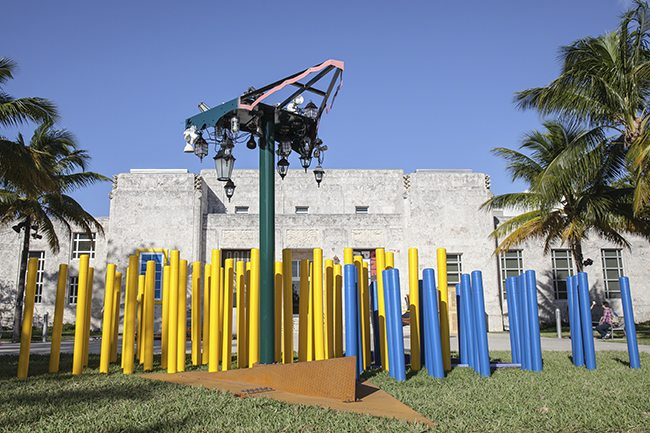 Jessica Stockholder. Installation view: Angled Tangle. Art Basel Miami, 2014. Steel, aluminium, auto paint, light fixtures, plastic bollards, gravel. Site-specific installation. Photograph: Joseph Rynkiewicz. Courtesy of the artist, Kavi Gupta Gallery, and Mitchell-Innes & Nash, NY.